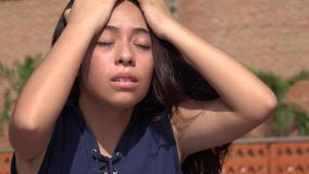 Teen Girl Headache Or Fever. Young pretty Colombian female teen Stock Photo