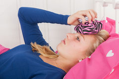 Teen girl with headache. Fourteen year old girl is having a headache Royalty Free Stock Images