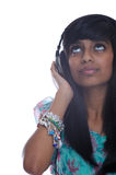 Teen girl with headphones. Teen girl from india listens to music Royalty Free Stock Images