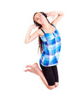 Teen girl in headphones  jumping Royalty Free Stock Photography