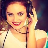 Teen girl in headphones listening music Stock Image