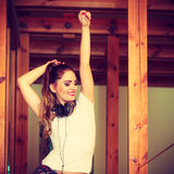 Teen girl in headphones listening music Royalty Free Stock Photos