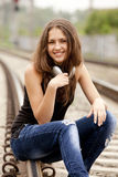 Teen girl with headphones at railways. Royalty Free Stock Images