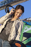 Teen Girl with Headphones and Record Stock Image