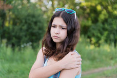 Teen girl with health problems in nature in summer Stock Photo