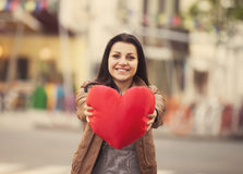 Teen girl with heart at outdoor. Royalty Free Stock Photos