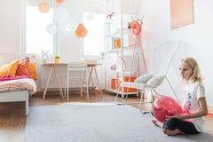 Teen girl in her bedroom Stock Images