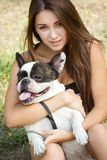 Teen girl with her french bulldog puppy Royalty Free Stock Image