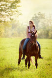 Teen girl on her horse Royalty Free Stock Photos