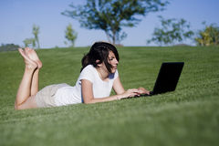 Teen girl on her laptop Stock Images