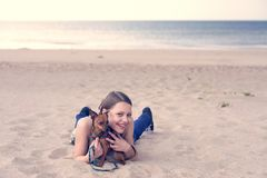 Teen girl with her puppy Stock Photography
