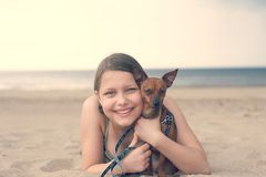 Teen girl with her puppy Stock Images