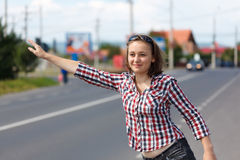 Teen girl hitch hiking Stock Photo