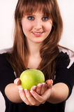 Teen girl holding an apple. Royalty Free Stock Photo
