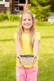 Teen girl holding basket with berry Royalty Free Stock Photos
