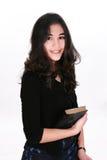 Teen girl holding Bible. Smiling Royalty Free Stock Photos