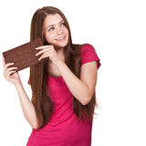 Teen girl holding big chocolate bar Royalty Free Stock Photo
