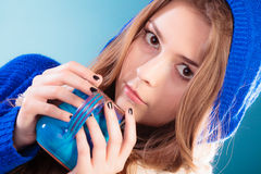 Teen girl holding blue mug with hot drink Royalty Free Stock Photography