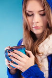 Teen girl holding blue mug with hot drink Stock Photography