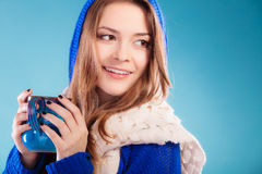 Teen girl holding blue mug with hot drink Royalty Free Stock Images