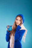 Teen girl holding blue mug with hot drink Stock Photo