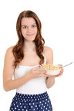 Teen girl holding bowl of cereal Royalty Free Stock Photography