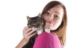 Teen girl holding cat. Stock Photos