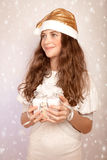 Teen girl holding Christmas gift Royalty Free Stock Photography