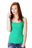 Teen girl holding cigarette. Royalty Free Stock Images