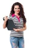 Teen girl holding a clipboard Royalty Free Stock Photos