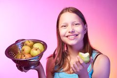 Teen girl holding a colander full of apples Royalty Free Stock Photography