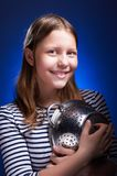Teen girl holding colander and smiling Royalty Free Stock Image
