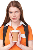 Teen girl holding disposable paper cup Stock Images