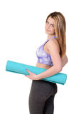 Teen girl holding exercise mat Royalty Free Stock Photography