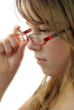 Teen girl holding glasses. Pretty teen girl looking through glasses Royalty Free Stock Images