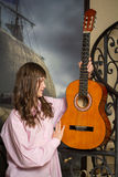 Teen girl holding a guitar Stock Photo
