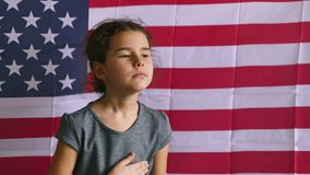 Teen girl holding hands on the heart  Independence usa Day American flag Fourth of July. Teen girl  holding hands on the heart  Independence usa Day American stock video
