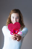 Teen girl holding hearts Stock Images