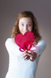 Teen girl holding hearts Royalty Free Stock Images