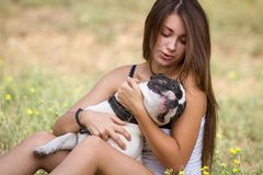 Teen girl holding her happy dog Royalty Free Stock Images