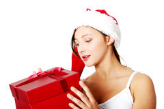 Teen girl holding and looking at gift. royalty free stock images