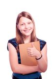 Teen girl holding paintbrush and paper and gesturing Royalty Free Stock Photography