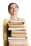 Teen girl holding pile of books. Royalty Free Stock Image