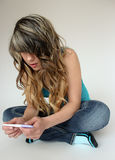 Teen girl holding a pregnancy test royalty free stock image
