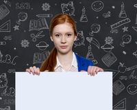 Teen girl holding a sign with copyspace for adverts. Teen business woman holding a sign with copyspace for adverts Royalty Free Stock Photography