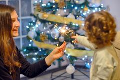 Teen girl holding sparklers Stock Photography