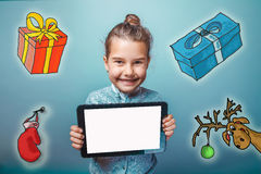 Teen girl  holding a tablet New Year gifts around Stock Photos