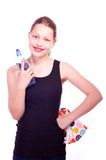 Teen girl holding towel and bottle of water Stock Image