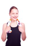 Teen girl holding towel and bottle of water Stock Photos