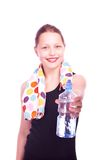 Teen girl holding towel and bottle of water Royalty Free Stock Photos